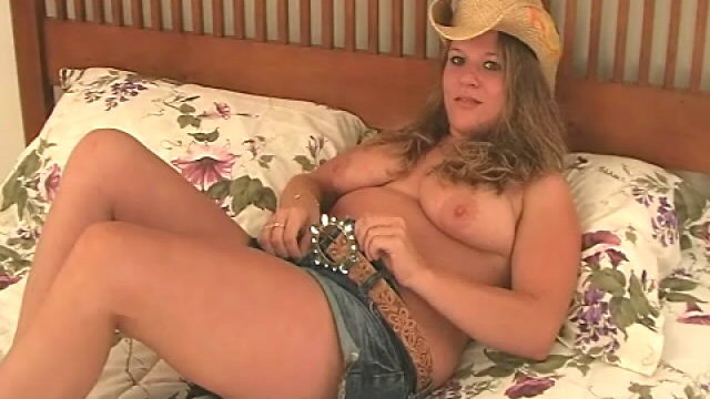 Bombshell Blondie Cowgirl Christy Undressing And Demonstrating Her Giant Breasts In Bed Room
