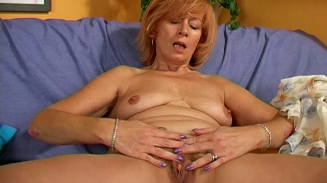 Nasty Granny Woman Stripping Panties And Taking Part In Together With Her Furry Pussy On The Sofa